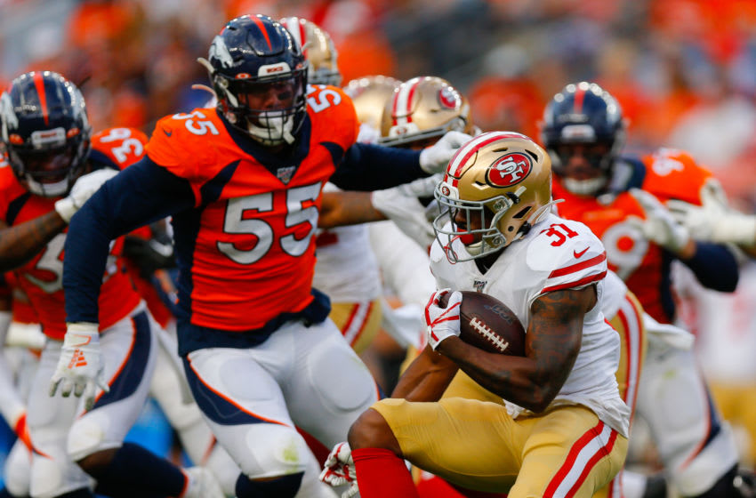 DENVER, CO - AUGUST 19: Running back Raheem Mostert #31 of the San Francisco 49ers runs with the football past outside linebacker Bradley Chubb #55 of the Denver Broncos during the first quarter of a preseason game at Broncos Stadium at Mile High on August 19, 2019 in Denver, Colorado. (Photo by Justin Edmonds/Getty Images)