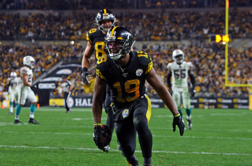 PITTSBURGH, PA - OCTOBER 28: JuJu Smith-Schuster #19 of the Pittsburgh Steelers celebrates after catching a 26 yard touchdown pass in the second half against Chris Lammons #30 of the Miami Dolphins on October 28, 2019 at Heinz Field in Pittsburgh, Pennsylvania. (Photo by Justin K. Aller/Getty Images)