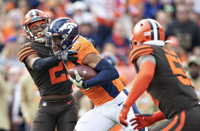 DENVER, CO - NOVEMBER 3: Courtland Sutton #14 of the Denver Broncos runs the ball and stiff arms Denzel Ward #21 of the Cleveland Browns at Broncos Stadium at Mile High on November 3, 2019 in Denver, Colorado. The Broncos defeated the Browns 24-19. (Photo by Wesley Hitt/Getty Images)