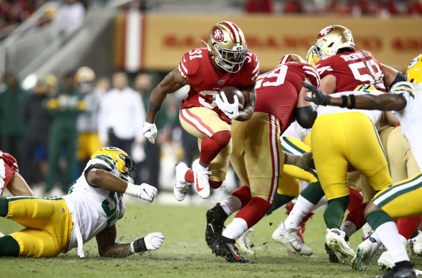 SANTA CLARA, CALIFORNIA - NOVEMBER 24: Raheem Mostert #31 of the San Francisco 49ers breaks through the line in route to running in for a touchdown against the Green Bay Packers at Levi's Stadium on November 24, 2019 in Santa Clara, California. (Photo by Ezra Shaw/Getty Images)