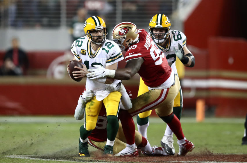 SANTA CLARA, CALIFORNIA - NOVEMBER 24: Aaron Rodgers #12 of the Green Bay Packers is tackled by Arik Armstead #91 and DeForest Buckner #99 of the San Francisco 49ers at Levi's Stadium on November 24, 2019 in Santa Clara, California. (Photo by Ezra Shaw/Getty Images)