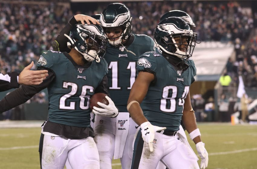 PHILADELPHIA, PA - DECEMBER 22: Miles Sanders #26, Carson Wentz #11, and Greg Ward #84 of the Philadelphia Eagles react in the final moments of the game against the Dallas Cowboys at Lincoln Financial Field on December 22, 2019 in Philadelphia, Pennsylvania. The Eagles defeated the Cowboys 17-9. (Photo by Mitchell Leff/Getty Images)