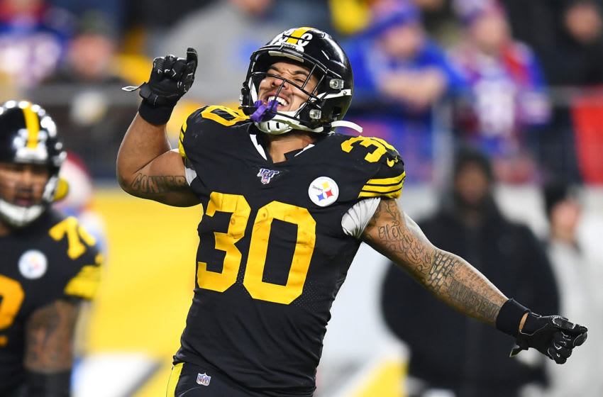 PITTSBURGH, PENNSYLVANIA - DECEMBER 15: James Conner #30 of the Pittsburgh Steelers celebrates scoring a touchdown during the third quarter against the Buffalo Bills in the game at Heinz Field on December 15, 2019 in Pittsburgh, Pennsylvania. (Photo by Joe Sargent/Getty Images)