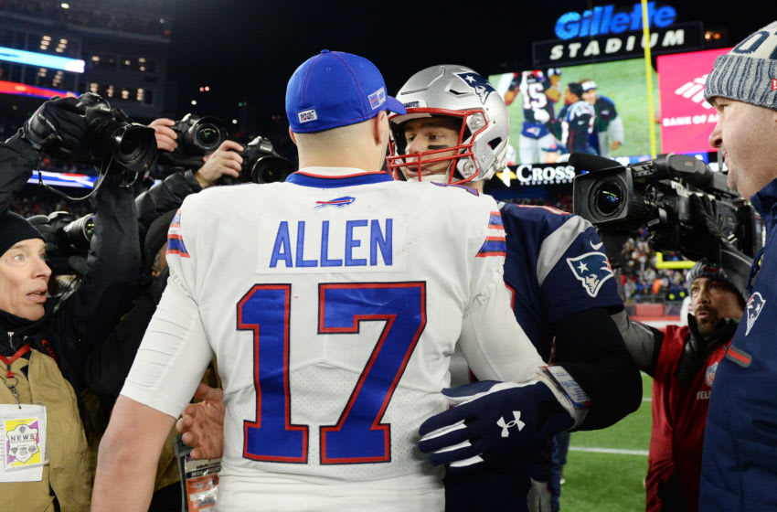 FOXBOROUGH, MASSACHUSETTS - DECEMBER 21: Josh Allen #17 of the Buffalo Bills shakes hands with Tom Brady #12 of the New England Patriots after the Patriots defeated the Bills 24-17 in the game at Gillette Stadium on December 21, 2019 in Foxborough, Massachusetts. (Photo by Kathryn Riley/Getty Images)