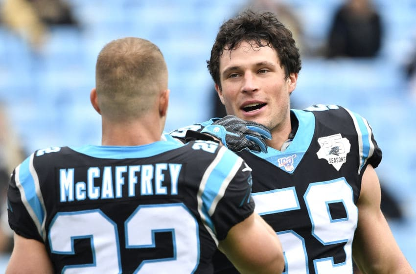 CHARLOTTE, NORTH CAROLINA - DECEMBER 29: Christian McCaffrey #22 and Luke Kuechly #59 of the Carolina Panthers warms up during their game against the New Orleans Saints at Bank of America Stadium on December 29, 2019 in Charlotte, North Carolina. (Photo by Grant Halverson/Getty Images)