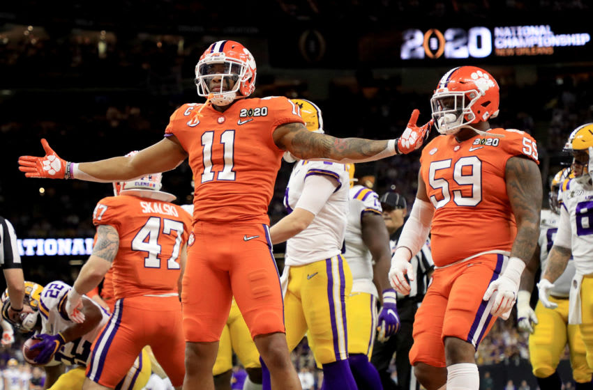 NEW ORLEANS, LOUISIANA - JANUARY 13: Isaiah Simmons #11 of the Clemson Tigers celebrates a defensive stop against the LSU Tigers during the first quarter in the College Football Playoff National Championship game at Mercedes Benz Superdome on January 13, 2020 in New Orleans, Louisiana. (Photo by Mike Ehrmann/Getty Images)