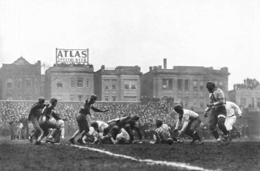 The Chicago Bears recover their quarterback's fumble and go on to win the first scheduled NFL Football Championship game over the New York Giants at Wrigley Field in Chicago by a score of 23-21, Chicago, Illinois, December 17, 1933. (Photo by Underwood Archives/Getty Images)