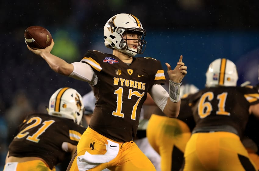 SAN DIEGO, CA - DECEMBER 21: Josh Allen #17 of the Wyoming Cowboys passes the ball during the first half of the Poinsettia Bowl at Qualcomm Stadium on December 21, 2016 in San Diego, California. (Photo by Sean M. Haffey/Getty Images)