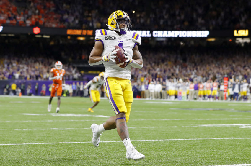 NEW ORLEANS, LOUISIANA - JANUARY 13: Ja'Marr Chase #1 of the LSU Tigers scores a touchdown during the first half against the Clemson Tigers in the College Football Playoff National Championship game at Mercedes Benz Superdome on January 13, 2020 in New Orleans, Louisiana. (Photo by Kevin C. Cox/Getty Images)
