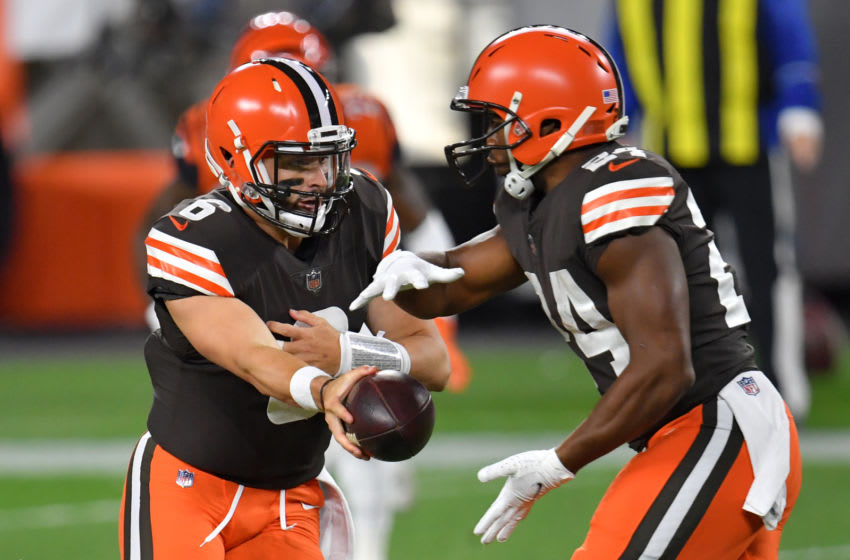 CLEVELAND, OHIO - SEPTEMBER 17: Baker Mayfield #6 hands off to Nick Chubb #24 of the Cleveland Browns against the Cincinnati Bengals during the first quarter at FirstEnergy Stadium on September 17, 2020 in Cleveland, Ohio. (Photo by Jason Miller/Getty Images)