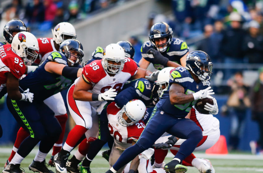 SEATTLE, WA - DECEMBER 31: Running back Mike Davis #39 of the Seattle Seahawks rushes against the Arizona Cardinals in the third quarter at CenturyLink Field on December 31, 2017 in Seattle, Washington. (Photo by Jonathan Ferrey/Getty Images)