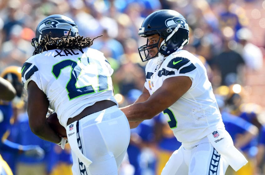 LOS ANGELES, CA - OCTOBER 08: Russell Wilson #3 of the Seattle Seahawks hands the ball of to Eddie Lacy #27 of the Seattle Seahawks during the first quarter of the game against the Los Angeles Rams at the Los Angeles Memorial Coliseum on October 8, 2017 in Los Angeles, California. (Photo by Harry How/Getty Images)