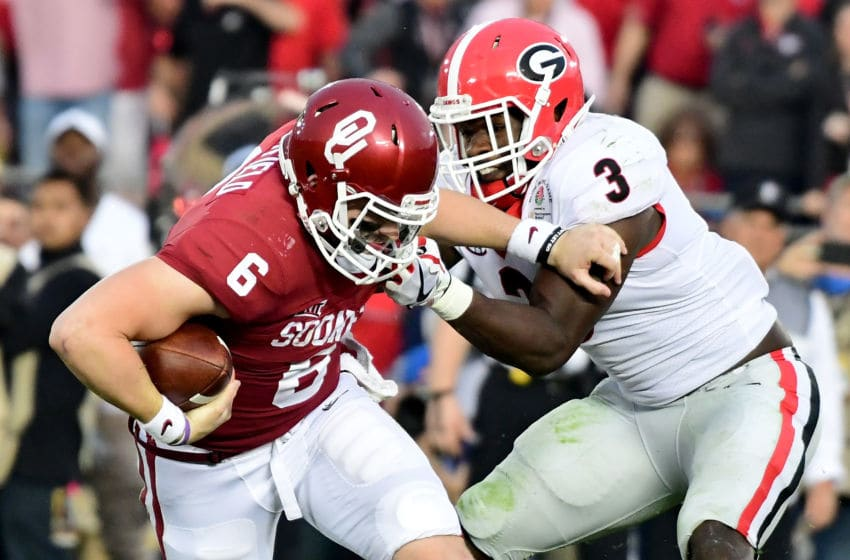 PASADENA, CA - JANUARY 01: Quarterback Baker Mayfield #6 of the Oklahoma Sooners looks to avoid a sack by linebacker Roquan Smith #3 of the Georgia Bulldogs in the second half in the 2018 College Football Playoff Semifinal at the Rose Bowl Game presented by Northwestern Mutual at the Rose Bowl on January 1, 2018 in Pasadena, California. (Photo by Harry How/Getty Images)