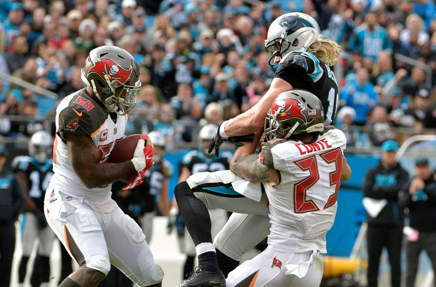 CHARLOTTE, NC - DECEMBER 24: Kwon Alexander #58 of the Tampa Bay Buccaneers intercepts a pass to Brenton Bersin #11 of the Carolina Panthers in the third quarter during their game at Bank of America Stadium on December 24, 2017 in Charlotte, North Carolina. (Photo by Grant Halverson/Getty Images)