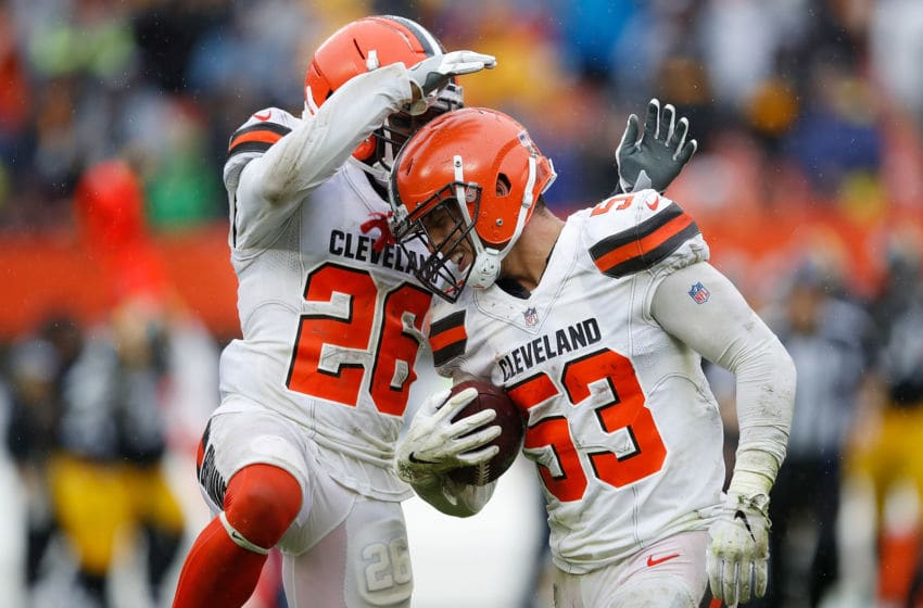 CLEVELAND, OH - SEPTEMBER 09: Joe Schobert #53 of the Cleveland Browns celebrates his fumble recovery with Derrick Kindred #26 during the fourth quarter against the Pittsburgh Steelers at FirstEnergy Stadium on September 9, 2018 in Cleveland, Ohio. (Photo by Joe Robbins/Getty Images)