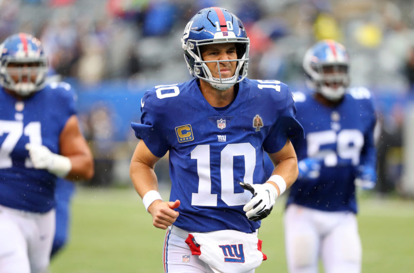 EAST RUTHERFORD, NJ - SEPTEMBER 09: Eli Manning #10 of the New York Giants runs off the field after warmups before the game against the Jacksonville Jaguars at MetLife Stadium on September 9, 2018 in East Rutherford, New Jersey. (Photo by Mike Lawrie/Getty Images)