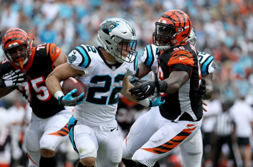CHARLOTTE, NC - SEPTEMBER 23: Christian McCaffrey #22 of the Carolina Panthers runs the ball against Carlos Dunlap #96 of the Cincinnati Bengals in the fourth quarter during their game at Bank of America Stadium on September 23, 2018 in Charlotte, North Carolina. (Photo by Streeter Lecka/Getty Images)