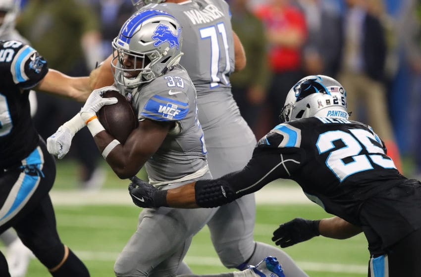 DETROIT, MI - NOVEMBER 18: Running back Kerryon Johnson #33 of the Detroit Lions runs for yardage against Eric Reid #25 of the Carolina Panthers during the first half at Ford Field on November 18, 2018 in Detroit, Michigan. (Photo by Gregory Shamus/Getty Images)