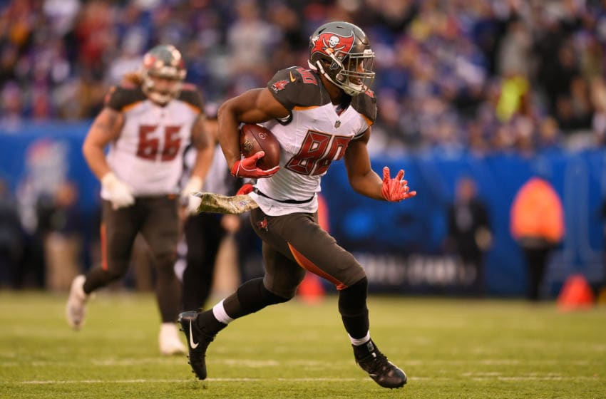 EAST RUTHERFORD, NJ - NOVEMBER 18: Tight end O.J. Howard #80 of the Tampa Bay Buccaneers carries the ball against the New York Giants during the fourth quarter at MetLife Stadium on November 18, 2018 in East Rutherford, New Jersey. The New York Giants won 38-35. (Photo by Sarah Stier/Getty Images)