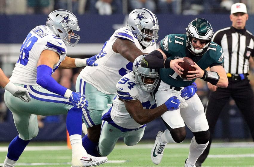 ARLINGTON, TEXAS - DECEMBER 09: Randy Gregory #94, Maliek Collins #96, and Tyrone Crawford #98 of the Dallas Cowboys sack Carson Wentz #11 of the Philadelphia Eagles in the first quarter at AT&T Stadium on December 09, 2018 in Arlington, Texas. (Photo by Richard Rodriguez/Getty Images)