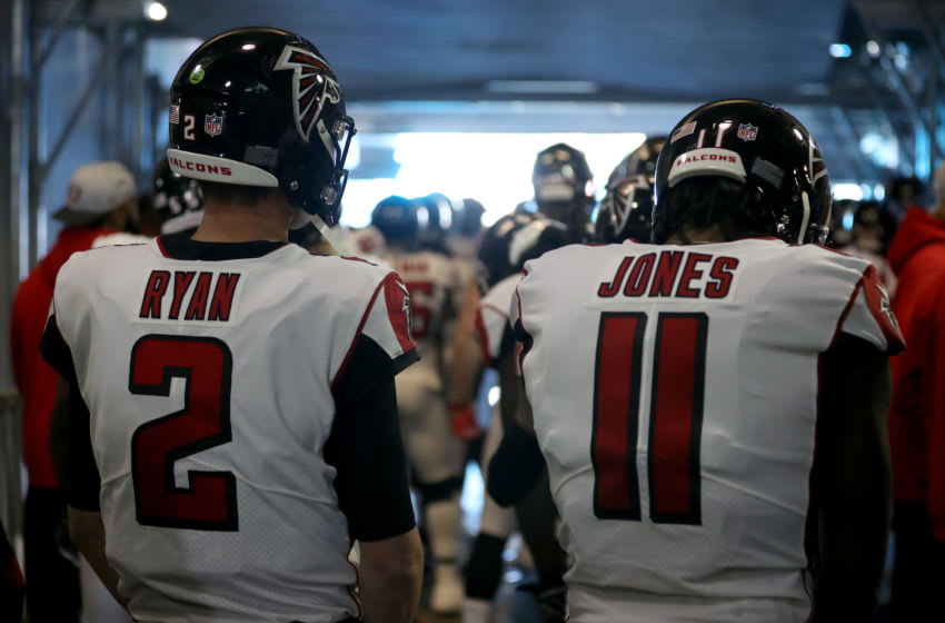CHARLOTTE, NORTH CAROLINA - DECEMBER 23: Matt Ryan #2 and teammate Julio Jones #11 of the Atlanta Falcons wait to take the field against the Carolina Panthers at Bank of America Stadium on December 23, 2018 in Charlotte, North Carolina. (Photo by Streeter Lecka/Getty Images)