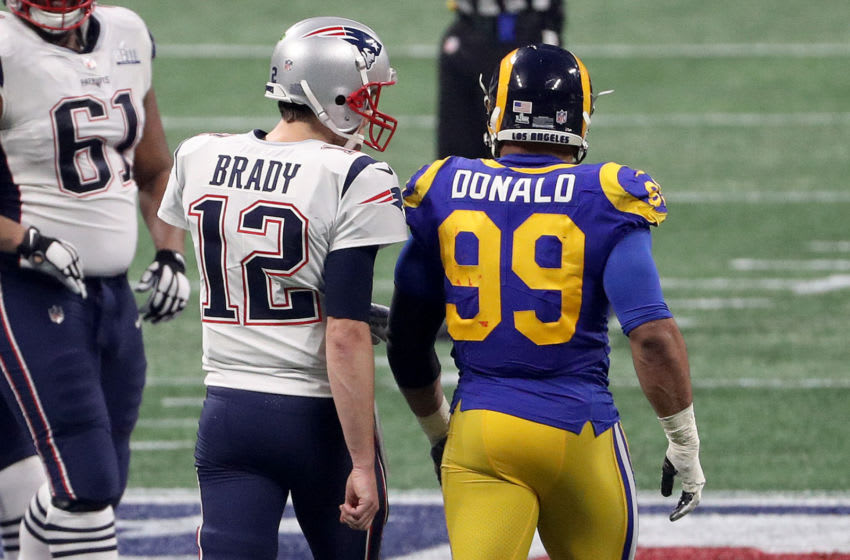 ATLANTA, GEORGIA - FEBRUARY 03: Tom Brady #12 of the New England Patriots speaks to Aaron Donald #99 of the Los Angeles Rams in the fourth quarter during Super Bowl LIII at Mercedes-Benz Stadium on February 03, 2019 in Atlanta, Georgia. (Photo by Patrick Smith/Getty Images)