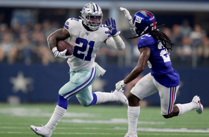ARLINGTON, TEXAS - SEPTEMBER 08: Ezekiel Elliott #21 of the Dallas Cowboys carries the ball against Janoris Jenkins #20 of the New York Giants in the second quarter at AT&T Stadium on September 08, 2019 in Arlington, Texas. (Photo by Tom Pennington/Getty Images)