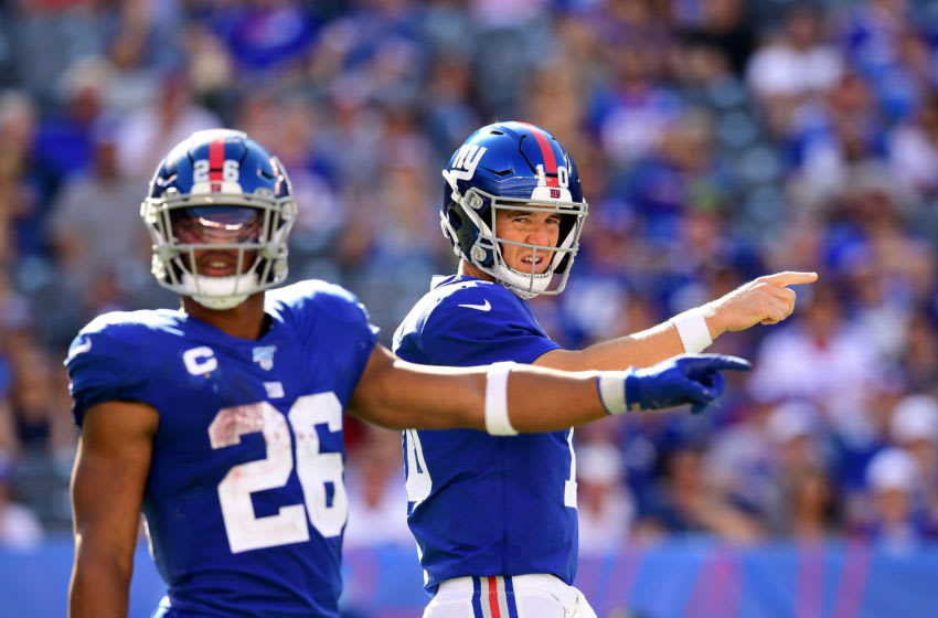 EAST RUTHERFORD, NEW JERSEY - SEPTEMBER 15: Saquon Barkley #26 of the New York Giants and Eli Manning #10 of the New York Giants communicate during their game against the Buffalo Bills at MetLife Stadium on September 15, 2019 in East Rutherford, New Jersey. (Photo by Emilee Chinn/Getty Images)