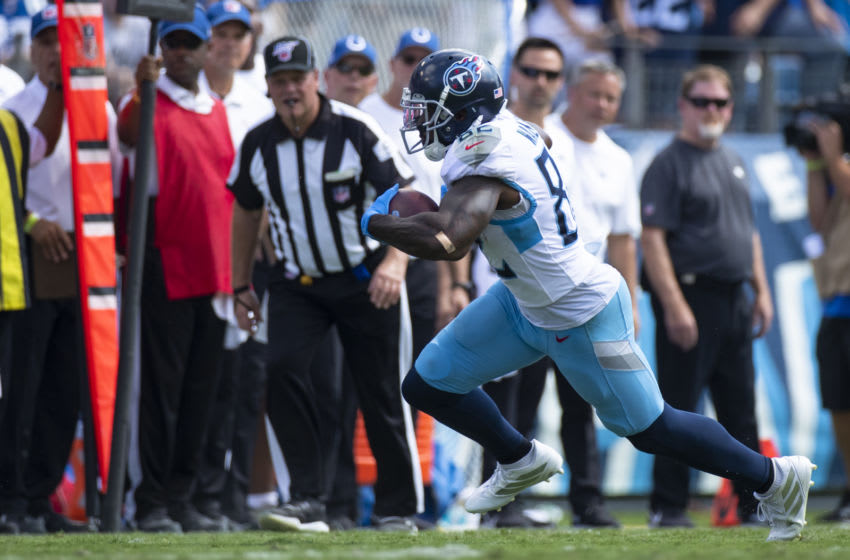 NASHVILLE, TN - SEPTEMBER 15: Delanie Walker #82 of the Tennessee Titans runs with the ball during the second quarter against the Indianapolis Colts at Nissan Stadium on September 15, 2019 in Nashville, Tennessee. Indianapolis defeats Tennessee 19-17. (Photo by Brett Carlsen/Getty Images)