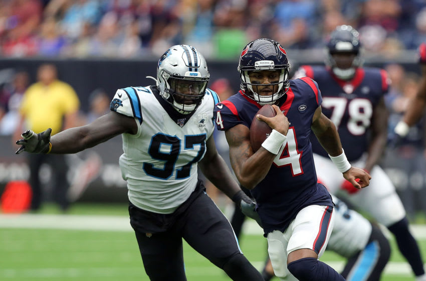 HOUSTON, TEXAS - SEPTEMBER 29: Deshaun Watson #4 of the Houston Texans rushes for a first down as Mario Addison #97 of the Carolina Panthers pursues at NRG Stadium on September 29, 2019 in Houston, Texas. (Photo by Bob Levey/Getty Images)