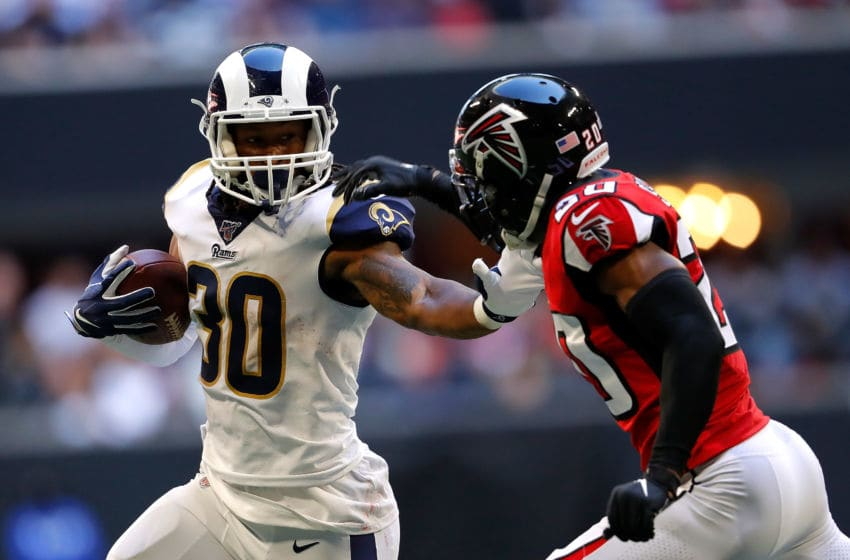 ATLANTA, GEORGIA - OCTOBER 20: Todd Gurley II #30 of the Los Angeles Rams rushes against Kendall Sheffield #20 of the Atlanta Falcons in the second half at Mercedes-Benz Stadium on October 20, 2019 in Atlanta, Georgia. (Photo by Kevin C. Cox/Getty Images)