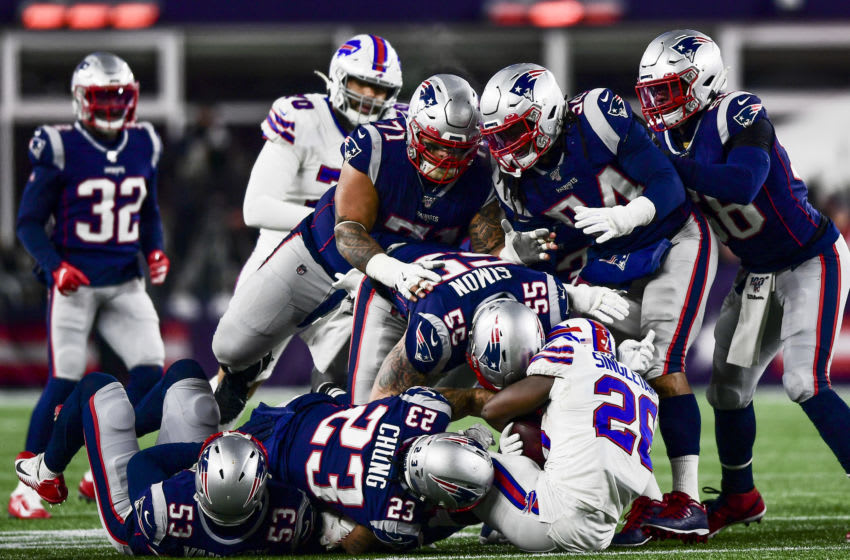 FOXBOROUGH, MA - DECEMBER 21: Members of the New England Patriots defense stop Devin Singletary #26 of the Buffalo Bills during the third quarter of a game at Gillette Stadium on December 21, 2019 in Foxborough, Massachusetts. (Photo by Billie Weiss/Getty Images)