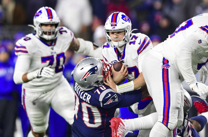 FOXBOROUGH, MA - DECEMBER 21: Josh Allen #17 of the Buffalo Bills is sacked by Adam Butler #70 of the New England Patriots during the fourth quarter of a game at Gillette Stadium on December 21, 2019 in Foxborough, Massachusetts. (Photo by Billie Weiss/Getty Images)