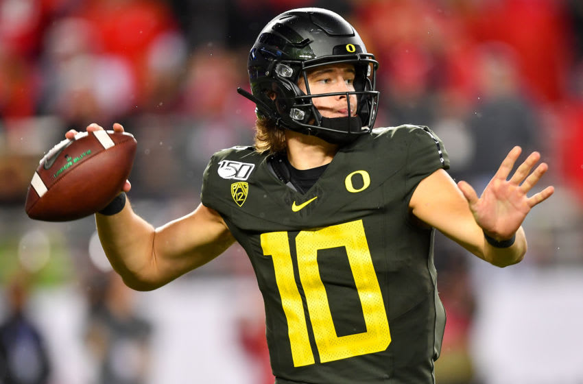 SANTA CLARA, CALIFORNIA - DECEMBER 06: Justin Herbert #10 of the Oregon Ducks throws the ball during the Pac-12 Championship football game against the Utah Utes at Levi's Stadium on December 6, 2019 in Santa Clara, California. The Oregon Ducks won 37-15. (Alika Jenner/Getty Images)