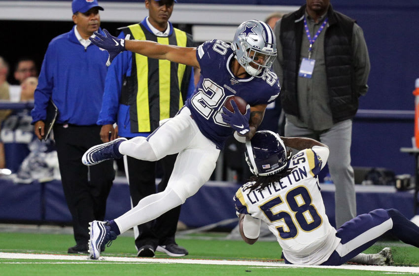 ARLINGTON, TEXAS - DECEMBER 15: Tony Pollard #20 of the Dallas Cowboys gets forced out of bounds by Cory Littleton #58 of the Los Angeles Rams in the third quarter at AT&T Stadium on December 15, 2019 in Arlington, Texas. (Photo by Richard Rodriguez/Getty Images)
