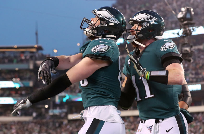 PHILADELPHIA, PENNSYLVANIA - DECEMBER 22: Dallas Goedert #88 of the Philadelphia Eagles celebrates with Carson Wentz #11 after scoring a touchdown during the first quarter against the Dallas Cowboys in the game at Lincoln Financial Field on December 22, 2019 in Philadelphia, Pennsylvania. (Photo by Mitchell Leff/Getty Images)