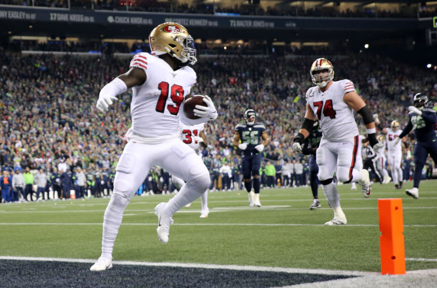 SEATTLE, WASHINGTON - DECEMBER 29: Wide receiver Deebo Samuel #19 of the San Francisco 49ers scores a touchdown against the during the first quarter of the game at CenturyLink Field on December 29, 2019 in Seattle, Washington. (Photo by Abbie Parr/Getty Images)