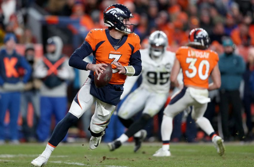 DENVER, COLORADO - DECEMBER 29: Quarterback Drew Lock #3 of the Denver Broncos rolls out of the pocket against the Oakland Raiders in the fourth quarter at Empower Field at Mile High on December 29, 2019 in Denver, Colorado. (Photo by Matthew Stockman/Getty Images)