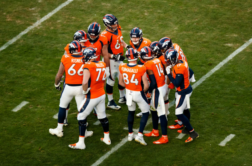 DENVER, CO - DECEMBER 29: The Denver Broncos huddle against the Oakland Raiders during the third quarter at Empower Field at Mile High on December 29, 2019 in Denver, Colorado. The Broncos defeated the Raiders 16-15. (Photo by Justin Edmonds/Getty Images)