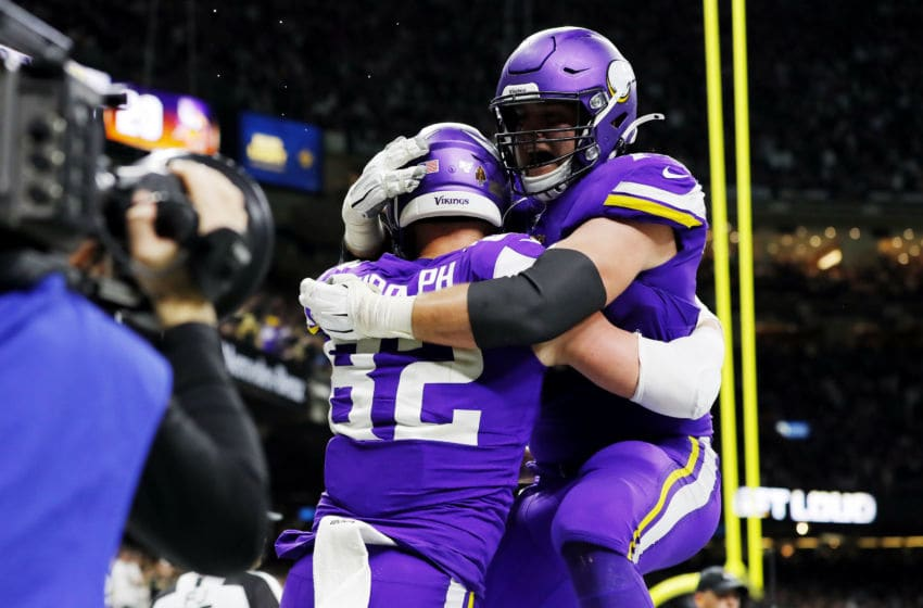 NEW ORLEANS, LOUISIANA - JANUARY 05: Kyle Rudolph #82 of the Minnesota Vikings celebrates with Brian O'Neill #75 after catching the game-winning touchdown reception against P.J. Williams #26 of the New Orleans Saints (not pictured) during overtime in the NFC Wild Card Playoff game at Mercedes Benz Superdome on January 05, 2020 in New Orleans, Louisiana. (Photo by Kevin C. Cox/Getty Images)