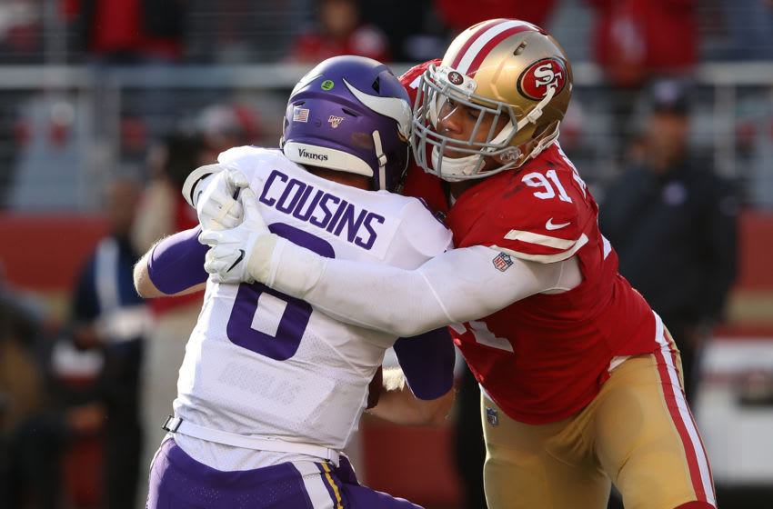 SANTA CLARA, CALIFORNIA - JANUARY 11: Kirk Cousins #8 of the Minnesota Vikings is sacked by Arik Armstead #91 of the San Francisco 49ers during the first half of the NFC Divisional Round Playoff game at Levi's Stadium on January 11, 2020 in Santa Clara, California. (Photo by Sean M. Haffey/Getty Images)