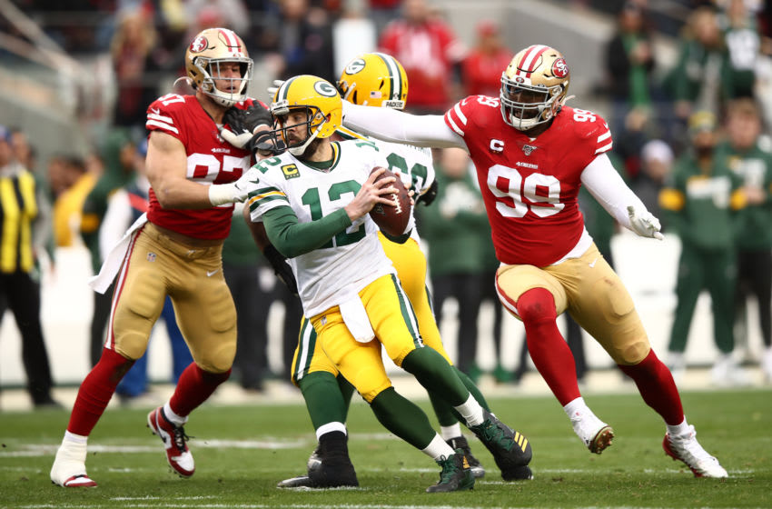 SANTA CLARA, CALIFORNIA - JANUARY 19: Aaron Rodgers #12 of the Green Bay Packers rolls out of the pocket during the NFC Championship game against the San Francisco 49ers at Levi's Stadium on January 19, 2020 in Santa Clara, California. (Photo by Ezra Shaw/Getty Images)