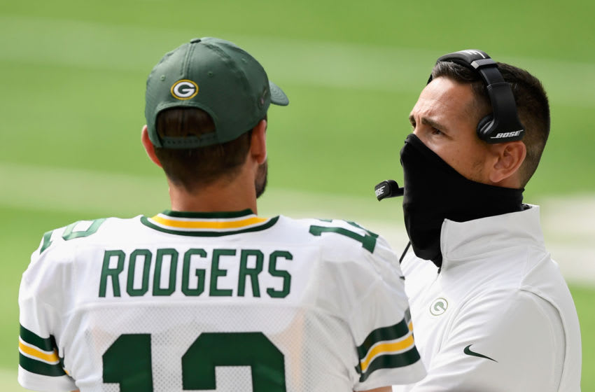 MINNEAPOLIS, MINNESOTA - SEPTEMBER 13: Aaron Rodgers #12 of the Green Bay Packers speaks with head coach Matt LaFleur during the fourth quarter of the game against the Minnesota Vikings at U.S. Bank Stadium on September 13, 2020 in Minneapolis, Minnesota. The Packers defeated the Vikings 43-34. (Photo by Hannah Foslien/Getty Images)