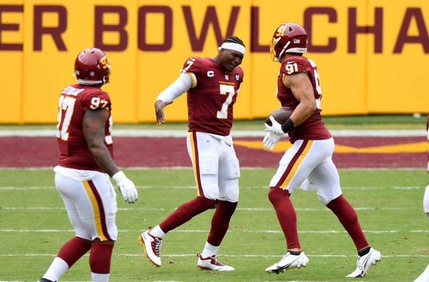 LANDOVER, MD - SEPTEMBER 13: Ryan Kerrigan #91 of the Washington Football Team celebrates with Dwayne Haskins #7 after recovering a fumble in the second half against the Philadelphia Eagles at FedExField on September 13, 2020 in Landover, Maryland. (Photo by Greg Fiume/Getty Images)