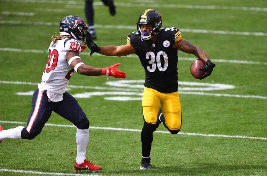 PITTSBURGH, PA - SEPTEMBER 27: James Conner #30 of the Pittsburgh Steelers carries the ball past the defense of Justin Reid #20 of the Houston Texans during the second quarter at Heinz Field on September 27, 2020 in Pittsburgh, Pennsylvania. (Photo by Joe Sargent/Getty Images)