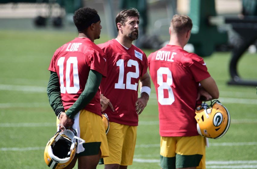 ASHWAUBENON, WISCONSIN - AUGUST 17: Aaron Rodgers #12 of the Green Bay Packers stands with Jordan Love #10 and Tim Boyle #8 during training camp at Ray Nitschke Field on August 17, 2020 in Ashwaubenon, Wisconsin. (Photo by Stacy Revere/Getty Images)
