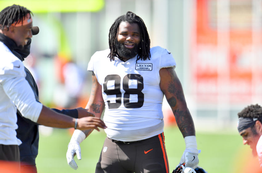BEREA, OHIO - AUGUST 18: Defensive tackle Sheldon Richardson #98 of the Cleveland Browns talks with teammates during NFL training camp on August 18, 2020 at the Browns training facility in Berea, Ohio. (Photo by Jason Miller/Getty Images)