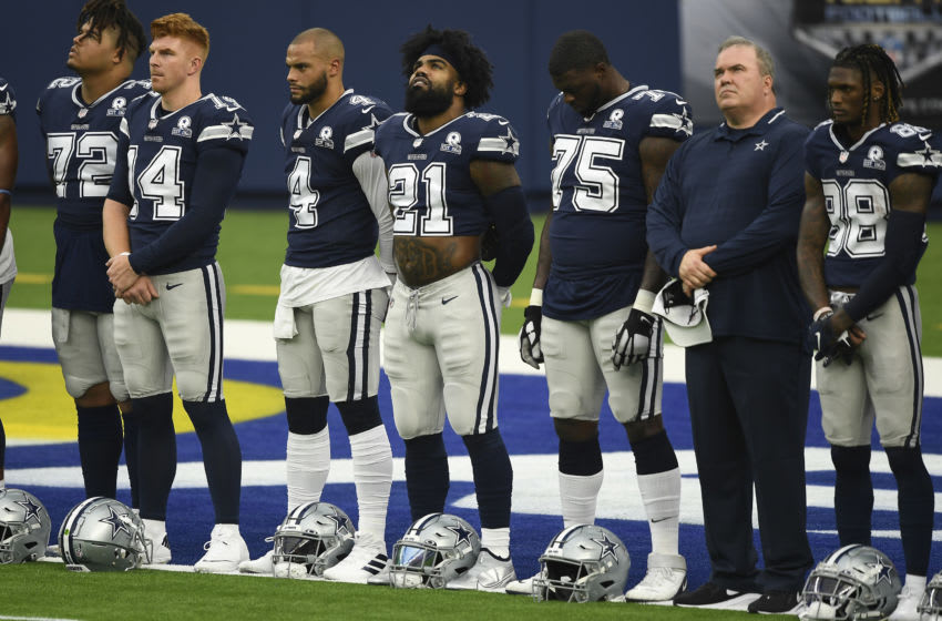 INGLEWOOD, CA - SEPTEMBER 13: From left to right, Trysten Hill #72, quarterbacks Andy Dalton #14 and Dak Prescott #4, running back Ezekiel Elliott #21, Cameron Erving #75, head coach Mike McCarthy and CeeDee Lamb #88, Michael Gallup #13, and Donovan Wilson #37 of the Dallas Cowboys stand during a ceremony after warm ups before the start of the football game against Los Angeles Rams at SoFi Stadium on September 13, 2020 in Inglewood, California. (Photo by Kevork Djansezian/Getty Images)