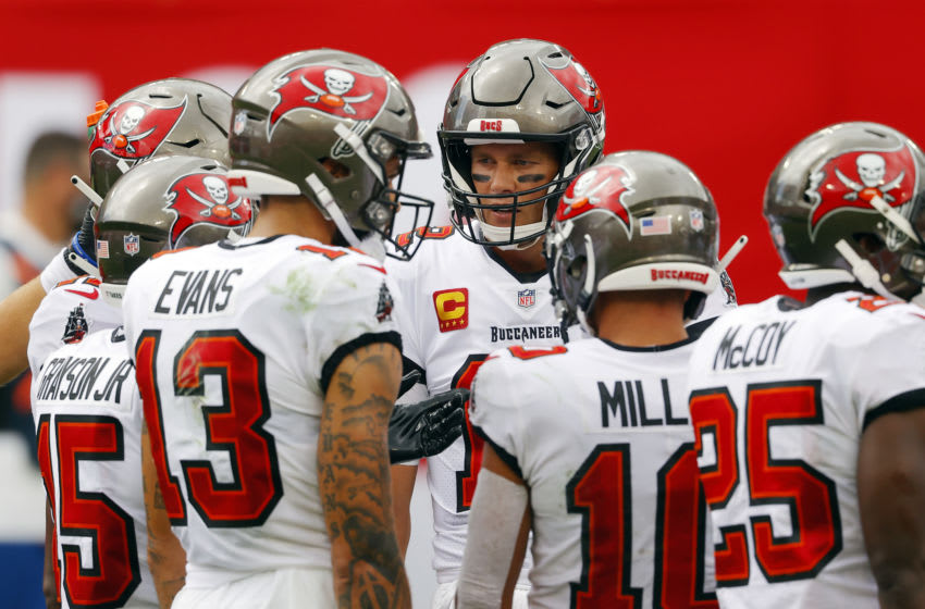 TAMPA, FLORIDA - SEPTEMBER 20: Tom Brady #12 of the Tampa Bay Buccaneers huddles with teammates during the first half against the Carolina Panthers at Raymond James Stadium on September 20, 2020 in Tampa, Florida. (Photo by Mike Ehrmann/Getty Images)