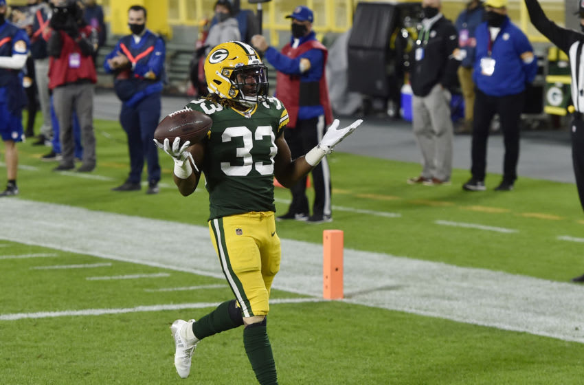 GREEN BAY, WISCONSIN - OCTOBER 05: Aaron Jones #33 of the Green Bay Packers scores a touchdown in the first quarter against the Atlanta Falcons at Lambeau Field on October 05, 2020 in Green Bay, Wisconsin. (Photo by Quinn Harris/Getty Images)